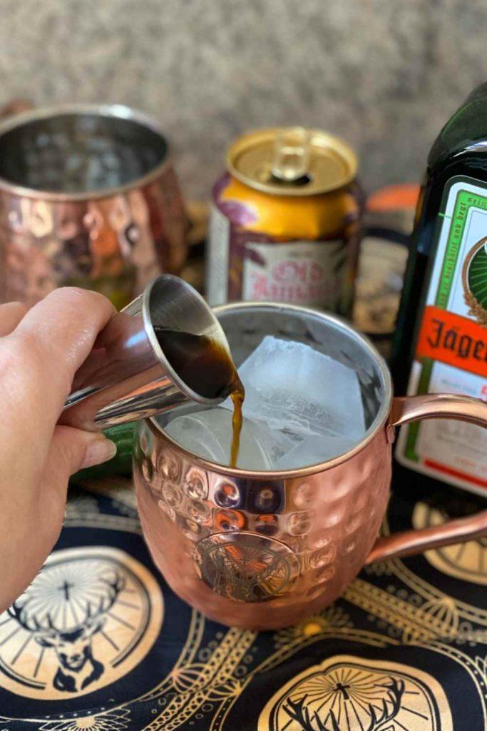 Adding coffee to Jägermeister Mule